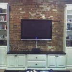 TV mounted on brick wall